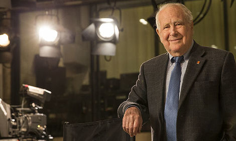 Lew Klein standing in a television studio