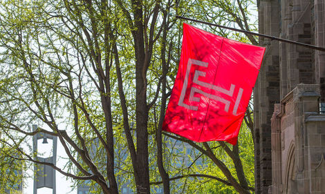 The Temple flag flies outside Sullivan Hall.