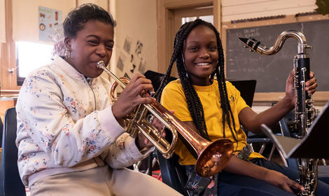 elementary school students playing instruments
