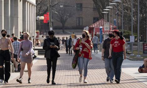 students walk along Liacouras Walk