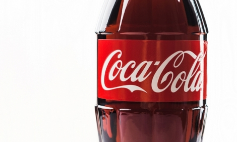 A plastic bottle featuring the iconic red and white Coca-Cola logo.