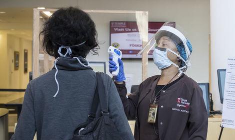 a medical assistant screening a patient