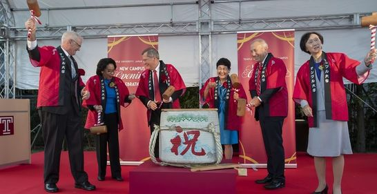 Temple University and Showa Women's University leadership break open a sake barrel to celebrate the official opening of TUJ's new campus.