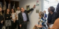 Stuart Holzer unveiling a plaque dedicating a painting studio to his wife