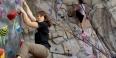 Zoe Steinberg climbing a rock wall