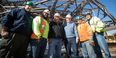 Construction workers standing together at the library site