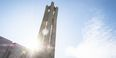 A sunbeam shining behind the Bell Tower.