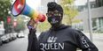 """Kendall Stephens wearing a sweatshirt and matching face mask that says """"QUEEN"""" with a rainbow megaphone."""