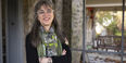 Author and Temple Professor Laura Levitt stands on the front porch of her home.
