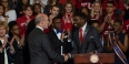 Gov. Tom Wolf shakes hands with student body President Tyrell Mann-Barnes