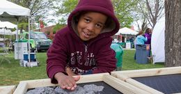 A child plays outside at Temple's Earth Fest.