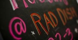 A chalkboard sign at Rad Dish Co-Op.