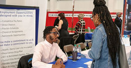 an employer tables at the job fair