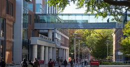 students walking on the Main Campus of Temple University in autumn