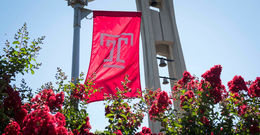 Temple flag flying by the Bell Tower.