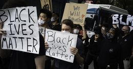protesters marching in Tokyo