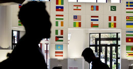 International flags hang in the Howard Gittis Student Center