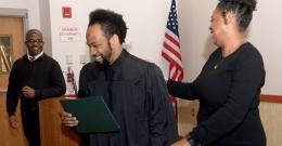 a graduate accepting his diploma