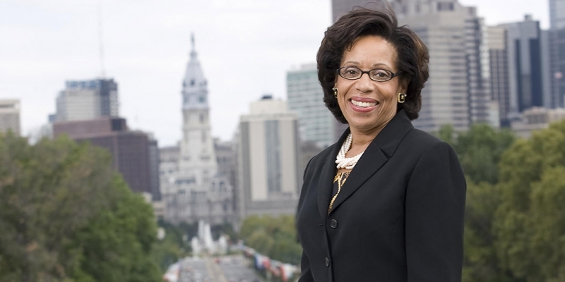 Temple Law School Dean JoAnn Epps with City Hall in the background.