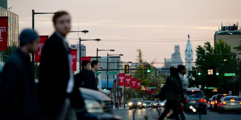 Pedestrians crossing Broad Street near Temple's Main Campus.