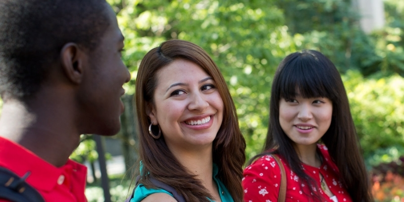 Three international students talking to each other on Temple's Main Campus.