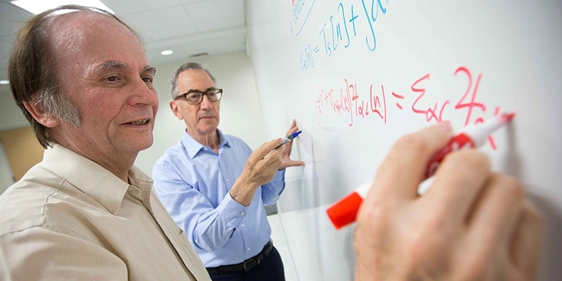 John Perdew working with the dean of the College of Science and Technology.