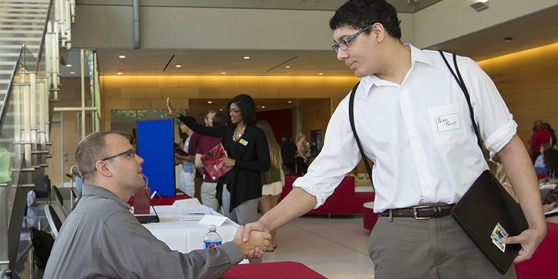 Student shaking hands with prospective employer.