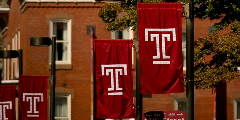 "Four Temple ""T"" flags on Main Campus."
