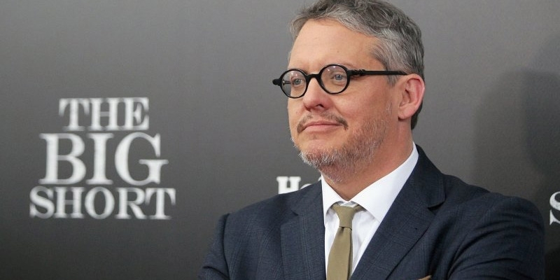 Adam McKay posing at an event for his film The Big Short.