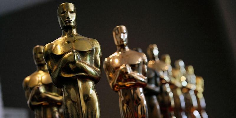 Several Oscar statuettes.
