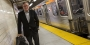 David Boardman standing next to a SEPTA subway train.