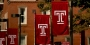 """Four Temple """"T"""" flags on Main Campus."""