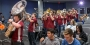 The Temple marching band playing in a lecture hall during pop-up pride celebration.
