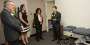 Temple President Neil D. Theobald tours the clinic with physical therapy students and CPH Dean Laura Siminoff