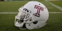 "A white Temple football helmet with a cherry Temple ""T"""