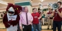 Ken and Kevin Acker celebrating with Hooter at a pop-up pride event.
