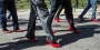 Men walking around Main Campus in red high heels.