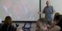 Jim Macmillan talking to students in a classroom.