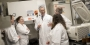 A team of scientists talking in a laboratory.