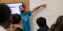 Assistant Professor Daniele Ramella pointing to a whiteboard while teaching.