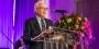 Larry Magid speaking at a podium