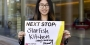 Lei Zhao holding a sign for her next stop, Starfish Kitchen.