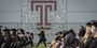 Graduates on the field at Edberg-Olson Athletic Hall during Commencement.