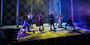 Students sing on stage during a performance of 'Spring Awakening.'