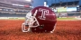 """A cherry Temple football helmet with a white Temple """"T."""""""