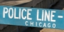 A wooden, blue police line barricade in Chicago.