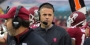 Rhule on the sidelines wearing a game headset