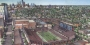 a sketched rendering showing an aerial view of the proposed stadium