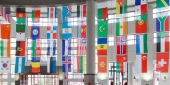 flags of countries around the world hanging in an atrium.