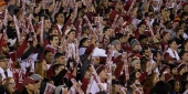 Crowds cheering at a Temple University football game.